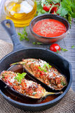 Eggplant stuffed with meat, rice and vegetables. In the pan Stock Photo