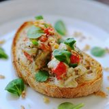 Eggplant tartare. Roasted eggplant and red pepper tartare on griled bread. Light diner stock photos