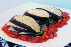 Eggplant terrine. Eggplant with hot red paprika chili sauce, green parsley and cheese Stock Photos