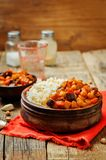 Eggplant and tomato chickpea curry with rice royalty free stock photo