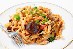 Eggplant in tomato sauce with pasta Royalty Free Stock Photography