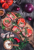 Eggplant and tomato stacks rustic above view Stock Photography
