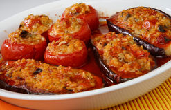 Eggplant and tomatoes filled with rice Stock Photo