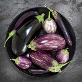 Eggplant Varieties in Black Bowl on Slate Overhead View royalty free stock photo