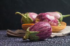 Eggplant varieties in wooden bowl Royalty Free Stock Photo