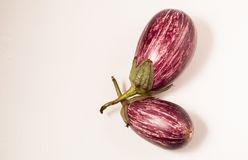 Eggplant on a white surface isolated. vegetarian food royalty free stock image