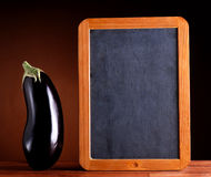 Eggplant on wooden table Royalty Free Stock Image