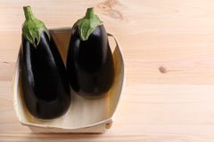 Eggplant on a wooden table stock images