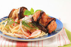 Eggplant wrapped meatballs with spaghetti Royalty Free Stock Photos