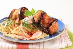 Eggplant wrapped meatballs with spaghetti Royalty Free Stock Photos