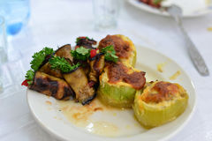 Eggplant, zucchini stuffed with meat, rice, and mushrooms, grated cheese Stock Photo
