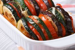 Eggplant, zucchini and tomatoes baked. Horizontal Royalty Free Stock Photos