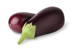 Eggplants. Isolated eggplants. Two fresh whole eggplants isolated on white background royalty free stock photo