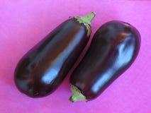 Eggplants. Beautyful eggplants on pink royalty free stock images