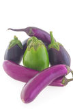Eggplants (aubergine) group on white background. Group of different shape and color eggplants (aubergines) on white background Stock Images