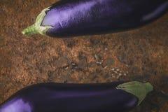 Eggplants on the brown stone background  horizontal Stock Photo
