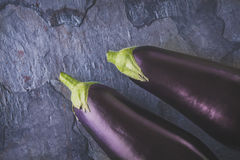 Eggplants on the dark stone table Royalty Free Stock Image