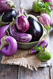 Eggplants of different variety on the table Stock Photography