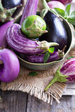 Eggplants of different variety on the table Royalty Free Stock Image