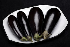 Eggplants on dish Royalty Free Stock Photos