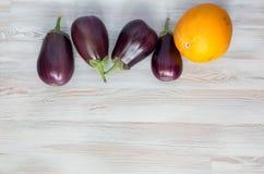 Eggplants and Melon on wood Background Stock Image