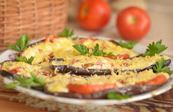 Eggplants with parsley and tomatoes stock photos