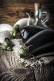 Eggplants on the rustic table vertical Royalty Free Stock Photography