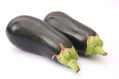 Eggplants. Some fresh eggplants on white background Royalty Free Stock Photo