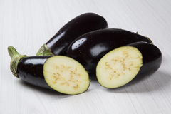 Eggplants. Some eggplants over a white wooden surface Stock Photo