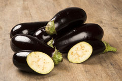 Eggplants. Some eggplants over a white wooden surface Royalty Free Stock Image