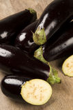 Eggplants. Some eggplants over a white wooden surface Stock Images
