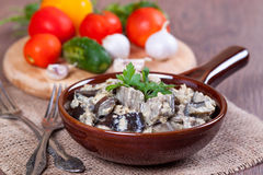 Eggplants in sour cream. On the desk Stock Image