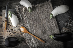 Eggplants  with spoon and knife on the rustic table horizontal Royalty Free Stock Images