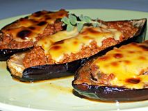 Eggplants stuffed minced meat. Eggplants stuffed with minced meat and topped with cheese stock photos
