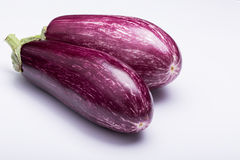 Eggplants. Two striped eggplants on white background Stock Photography