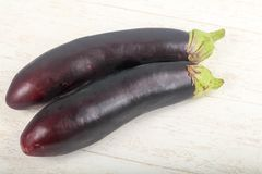 Eggplants. Two Eggplants on the wooden background royalty free stock photography