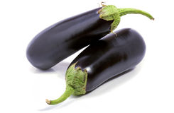 Eggplants on white Stock Images