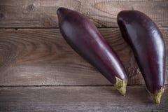 Eggplants on wooden background Stock Image