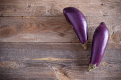 Eggplants on wooden background Royalty Free Stock Photo