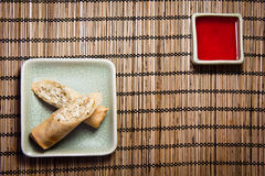 Eggroll. And red sauce on a bamboo mat Stock Image