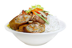 Eggroll Noodle. Bowl of noodle with eggrolls and vegetable, Vietnamese cuisine Royalty Free Stock Photos