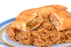 Eggroll and rice. Fried eggroll over rice meal Royalty Free Stock Photo