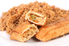 Eggroll and rice. Fried eggroll over rice meal Royalty Free Stock Image