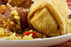 Eggroll with Sesame Chicken. Oriental meal with Sesame Chicken, eggroll and fried rice with vegetables Royalty Free Stock Photography