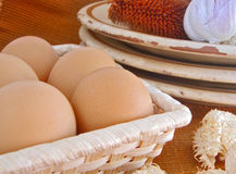 Eggs. Five eggs in straw basket Royalty Free Stock Photography