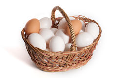 Eggs. Basket with eggs in it isolated on white background Stock Photo