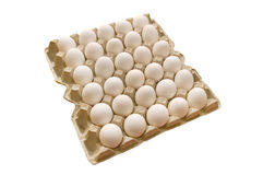 Eggs. Many white eggs lay in cells. On a white background Royalty Free Stock Photography