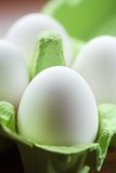 Eggs. White fresh eggs in green carton package Stock Photo
