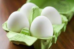 Eggs. White fresh eggs in green carton package Royalty Free Stock Photo