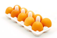 Eggs. Carton of eggs with front in focus, gradually blurring towards the back Royalty Free Stock Photography